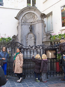 """Manneken Pis. """"Little man peeing."""" This statue is the original. All those little statues you see in gardens all over the world of a little boy peeing are copies of this one."""
