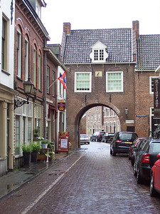 An arched home in the small, old, Dutch town of Buren. at one time this was probably a gate through the outer wall of the city. Now it is in the middle of town.
