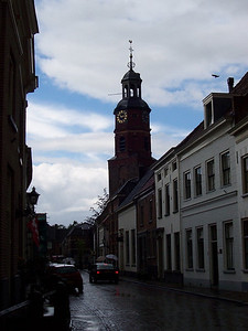 A view of the church tower in the small, old, Dutch town of Buren.