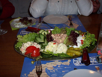 The first of three big food trays at a Greek restaurant in Holland.