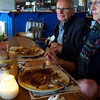 Caroline's parents at a Dutch pancake house. Dutch pancakes are a hearty meal. The batter is chewy like a crepe and the pancakes are loaded with ham, bacon, cheese, onions and all kinds of other toppings.