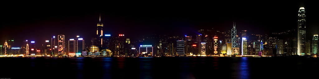 Hong Kong Island panorama. I merged 3 photos and wished now I had  taken more frames using my telephoto instead of wideangle. I took these in December '05 and the weather in Hong Kong felt like early autumn to me :-) You could see that the buildings were decorated with Christmas lights.