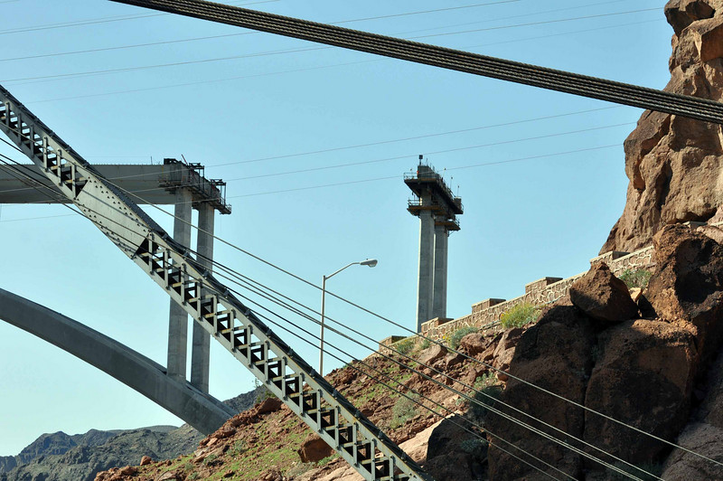 Hoover Dam 3/26/10. Bridge, under construction, with the power lines in the foreground.