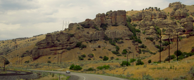 Last of the heavy duty rock formations as highway, railroad, and landscape iron out on approach to Ogden and environs.  Don't recall what became of the river...