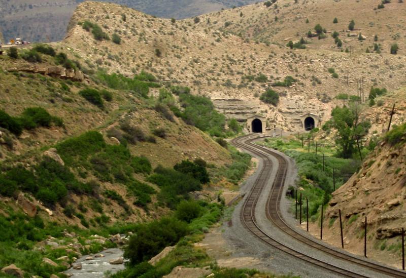 Ah, okay: TWO tunnels.  The rail line is former Denver & Rio Grande Western.