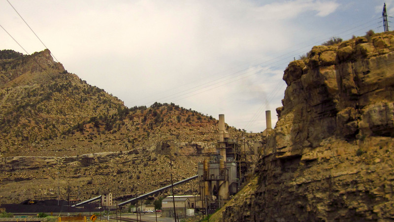 Coal-fired (pile of the stuff at left) powerplant in the mountains west of Helper.