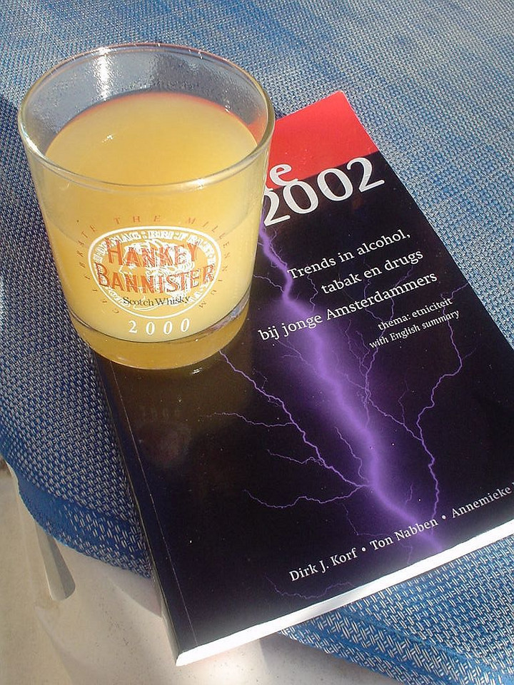 Book with the results of a study into drug habits of young Amsterdam people, with my Pina Colada on top of it! :)