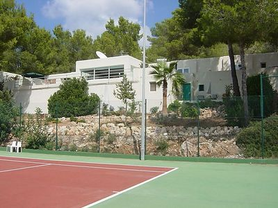 View of the house from the tennis court we share with the house next to it.