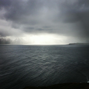 The weather is always changing and coming up with creative ways to show off. Here it's a rain storm with sun over a fjord called  Eyjafjordur. Northern end of Iceland on the way to Dalvik.