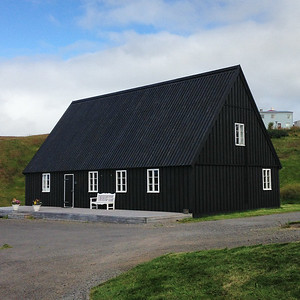Same village as duplex. In Iceland, the houses that stand out the most go one of two ways: black & white like this one or super colorful.