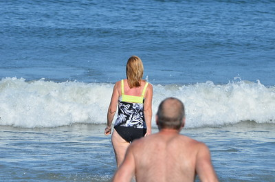 Kathy is really entering the water.   Bob is following her.