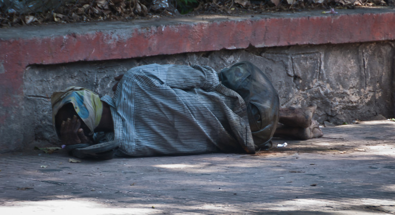 First, yeah, there is a lot of poverty here. This gentleman was the only one I saw sleeping on the walkway though. As we drove around you could occasionally see what appeared to be bedrolls/shelters in open areas.