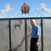 Kent Martin outside homemade gate by one of our Mongolian hosts.