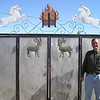 John Carlson outside homemade gate by one of our Mongolian hosts.