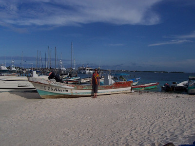 Caroline with some of the many fishing boats on the western beach.