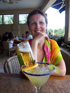 """Caroline having a """"Mammacita Margarita"""" at Jax. The inverted Corona bottle keeps your glass full as you begin to drink it down."""