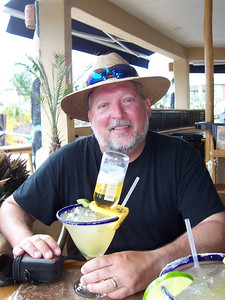 """Chris having a """"Mammacita Margarita"""" at Jax. The inverted Corona bottle keeps your glass full as you begin to drink it down."""
