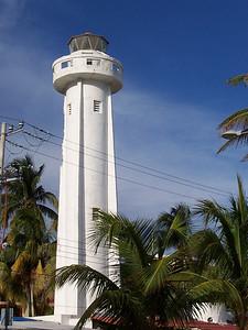 An old lighthouse downtown near the docks.