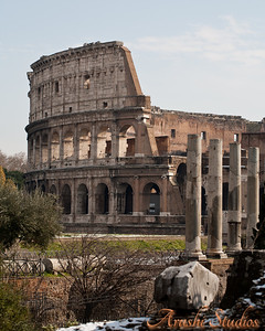 View of the colosseum from the titus arch in the forum romanum