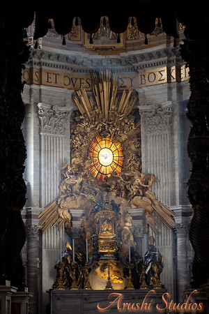 The main altar of St Peter's, framed by the bronze Bernini's baldacchino. In the background you can see the apse with St Peter's Cathedra supported by four Doctors of the Church.