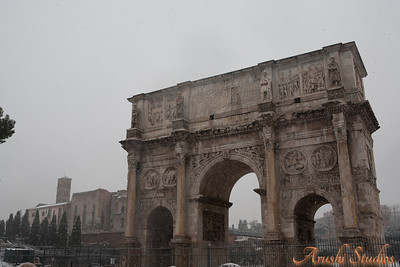 The Arch of Constantine is a triumphal arch, erected c. 315 CE to commemorate the triumph of Constantine I after his victory over Maxentius in the battle at the Milvian Bridge in 312 CE. The arch is located in the valley of the Colosseum, between the Palatine Hill and the Colosseum, along the road taken by the triumphal processions. The arch is the largest of only three such arches to survive in Rome today. The two others are the Arch of Titus and the Arch of Septimius Severus, both in the nearby Forum Romanum.