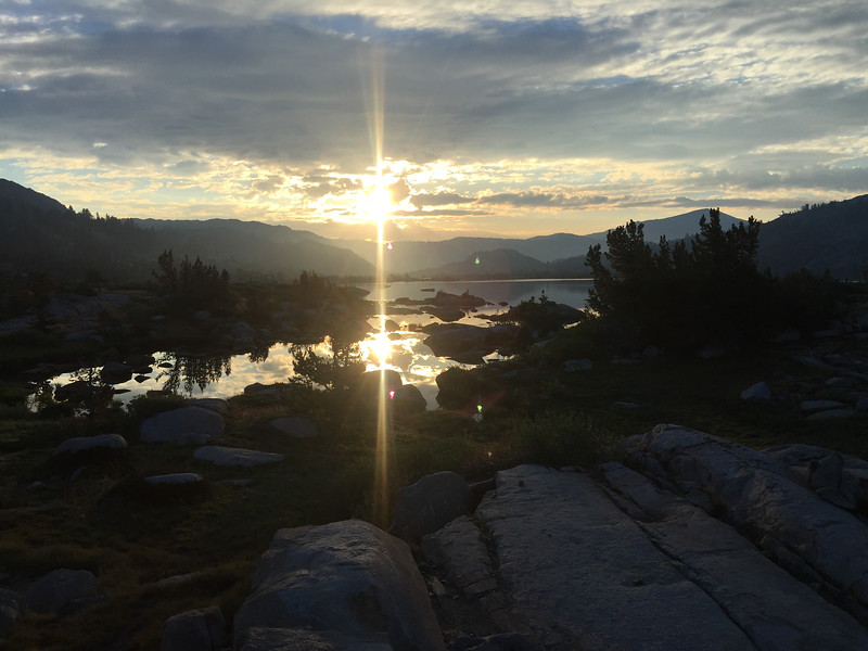Sunrise. We had an exciting night of having a SAR helicopter fly through around 10 pm and circle the lake 5 times with a searchlight on before finally landing, rescuing someone, and flying off again. The kids slept through it all.