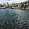 Swimming in Dollar Lake. The pointy rock is Fin Dome.