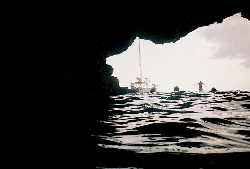This cave is a horseshoe, with two entrances.  As you're leaving, you've got to be mindful of the divers, such as the one seen in this photo.