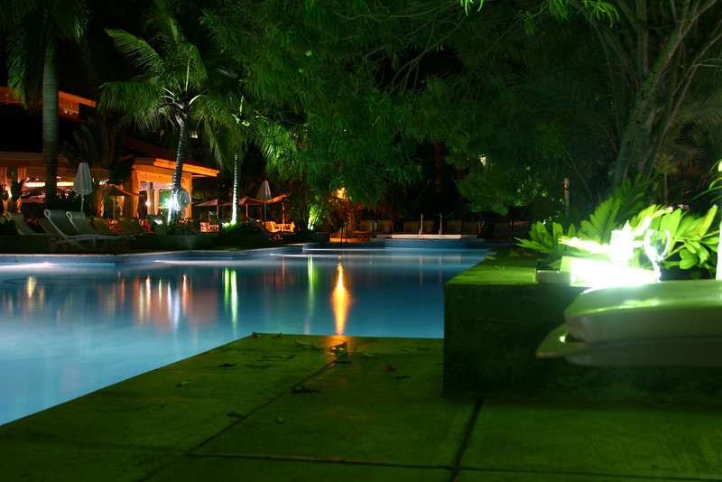 The beautiful colored lights reflecting on the pool... and off of a moth that was flying all around the light on the right.
