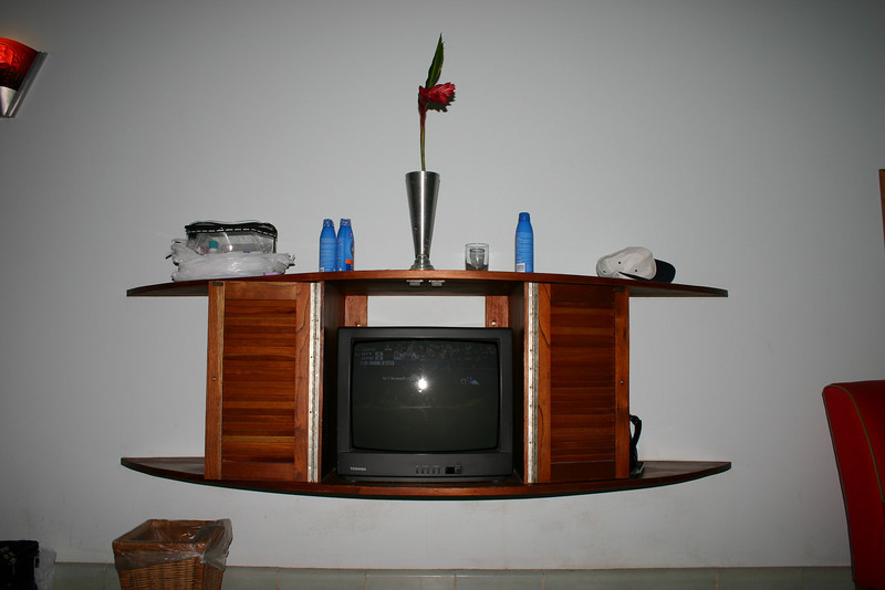 There's lots to do at the resort, but there's nothing wrong with spending an evening cuddled up with your sweetheart, watching a movie.  On the right side is a pitcher, with glasses, filled with ice water.  Also, the pretty flower on top adds a nice touch.