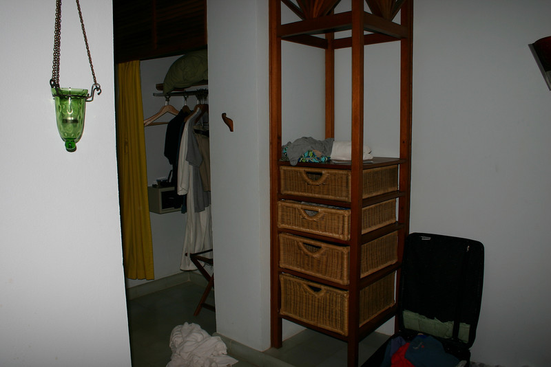 The rooms may be a little small, but the space is well used.  Here we see the corner dresser, which holds quite a bit.  On the left is the closet (with hangers), and the small room safe for your precious valuables.