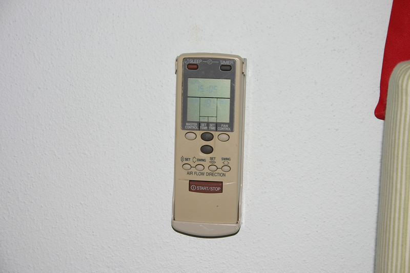 The air conditioner has a remote control!  Now you can be lazy, and control everything from the bed.  Unfortunately, we could never figure out how to change the temperature from Celcius to Farenheit.