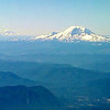from the plane Mt. Ranier in the foreground