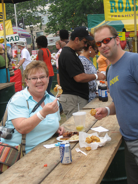 Eric and his Mom eating alligator nuggets at the Cajun Festival in Norfolk.
