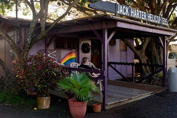 The Jack Harter headquarters; a shack along the road to the airport.<br /> -----<br /> La compagnie d'hélicoptères Jack Harter : une simple baraque en bois le long de la route pour l'aéroport.