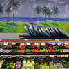 Koloa grocery store: vegetables, boogieboards and ocean...so Hawaii.