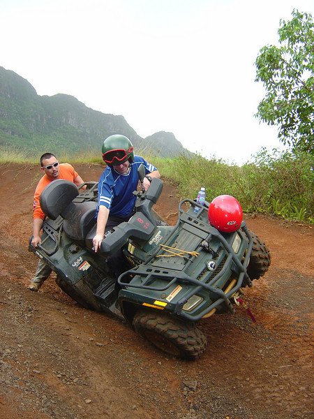 Tipping on an ATV for a demonstration of how stable the ATVs are...even without being held the ATV rocked back upright and did not tip over!  If it had and my leg stayed in place I would not be hurt as they are designed to leave that space open so one's leg doesn't get crushed.