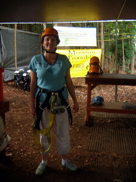 """Near Lihue (east side) in the forest, Wendy prepares for the zipline """"eco adventure""""  <a href=""""http://www.justlive.org"""">http://www.justlive.org</a>). Kauai."""