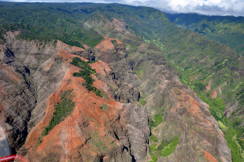 Waimea Canyon from the air. The red soil is iron-rich.