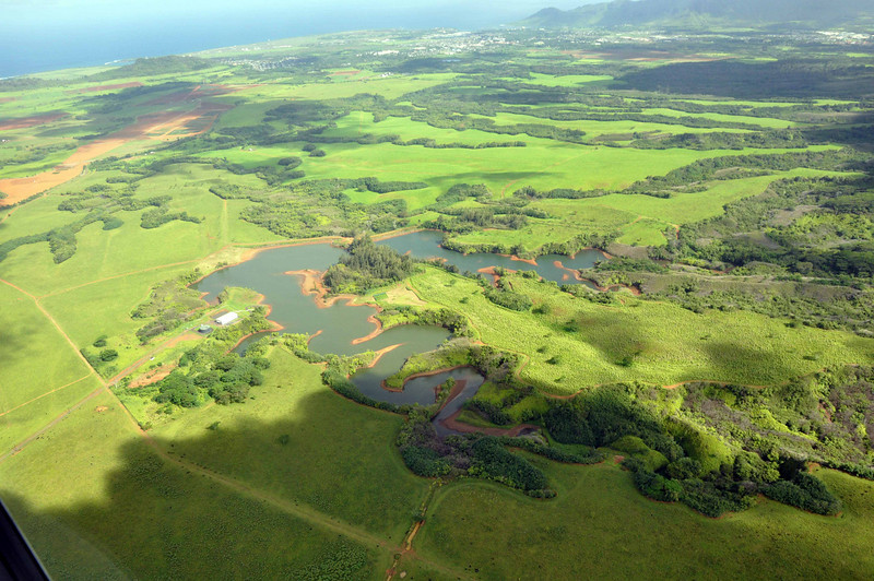 Heading toward the eastern side of Kauai, where the airport is located.