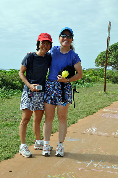 Longtime friends Zoe (left), a Kauai native, and Liz pose after the Kauai chalk run.