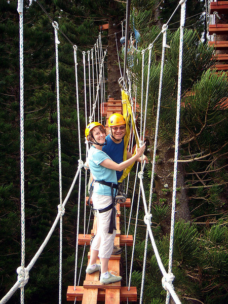 Rick and Wendy pause on the rope bridge. No, we're not scared (much). It's a healthy tingle in our stomachs that says we're very far off the ground.