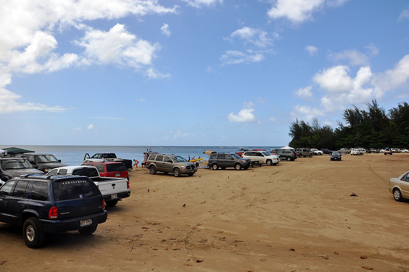 Drive right up to the edge of the beach on Hanalei Bay.