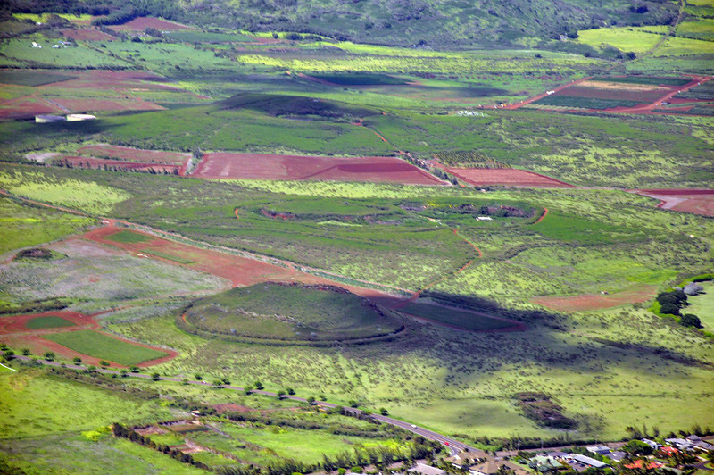 A small, dormant volcano in the middle of various fields.