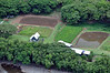 A small farm, visible from the edge of the road near the mouth of Waimea Canyon, near the southern shore of Kauai.