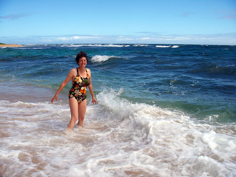 Wendy is enduring the rough waves in the edge of Hanalei Bay.