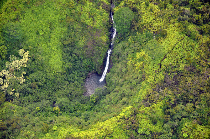 Waterfall in the north central portion of Kauai, away from the shoreline.