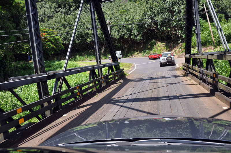 On the Kauai one-lane bridges, up to seven cars should cross together while the other wait before taking their turn. Seems to work pretty well, except with some tourists who fail to read the signs (not us!).
