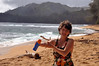 Wendy lathers on the sunscreen for a couple of hours at the beach. Even in the morning the sun is intense on Kauai.