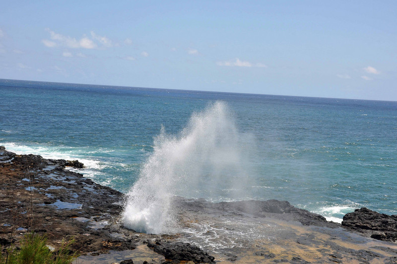 Spouting Horn is a hole on the surface, over a lava shelf. Wave and tide action cause water to shoot through the hole.